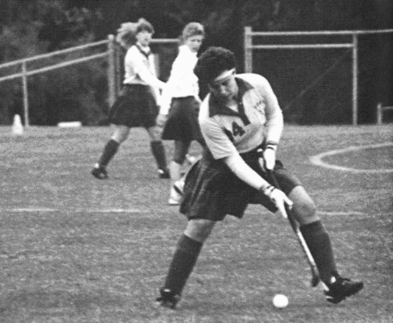 Beck playing field hockey in 1989