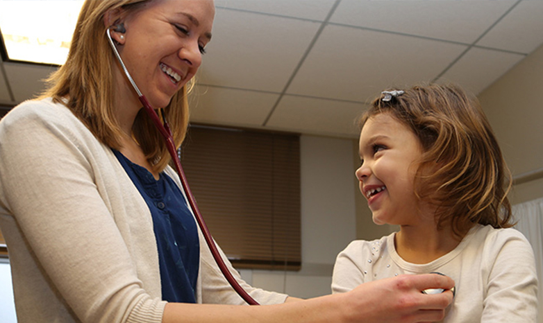 physicians assistant and child patient