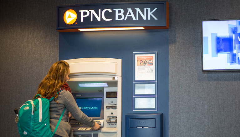 student using PNC teller machine