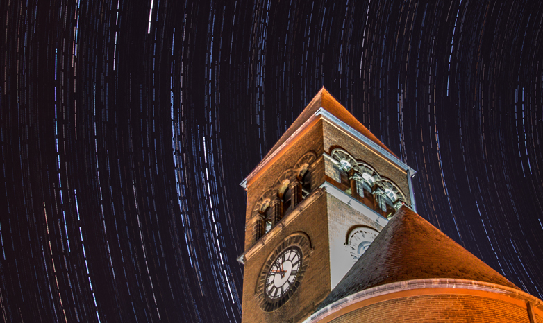 old main at night with star trail