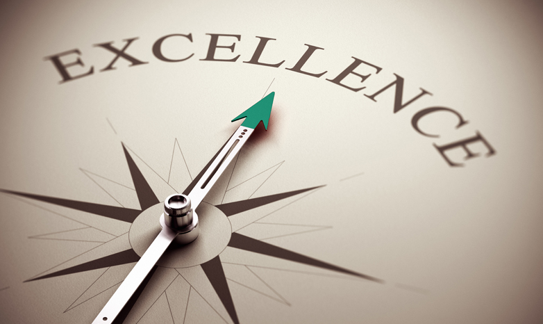compass points toward the word excellence