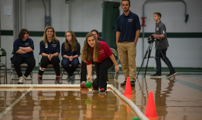 Slippery Rock University students in the adapted physical activity graduate program are coaching indoor bocce