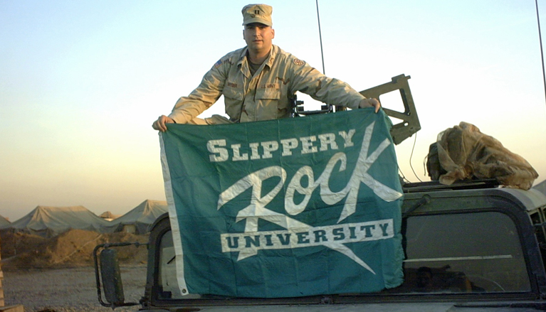 Robert Snyder, SRU professor of elementary education and a 1992 graduate, shows his colors while deployed as an Army officer in Iraq. Snyder served there in 2003-2004.