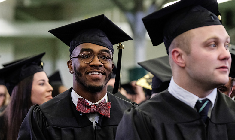 student at graduation with cap and gown
