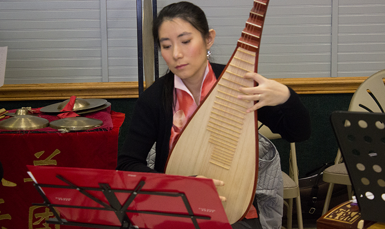 chinese new year musician playing stringed instrument