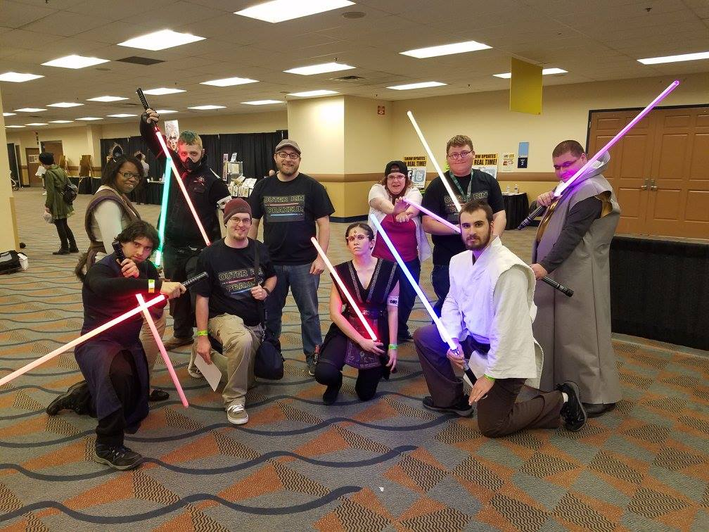 Cosplayers with lightsabers
