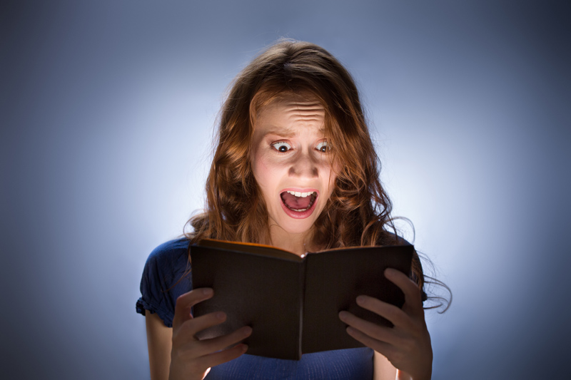 Woman reading scary book