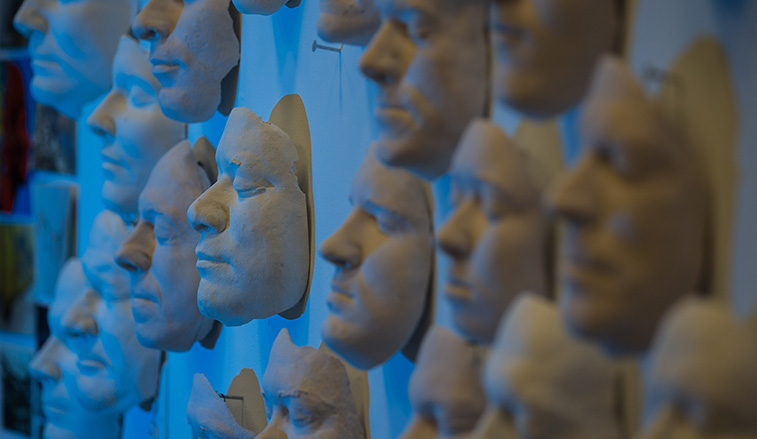 Face castings hanging on the wall