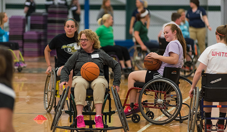 People playing wheelchair basketball