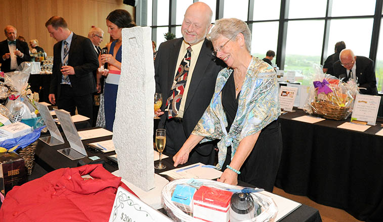 Gala attendees at a silent auction