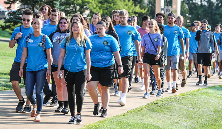 The class of 2022 make their way across campus to convocation