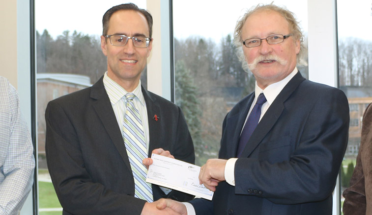 Donation check is presented