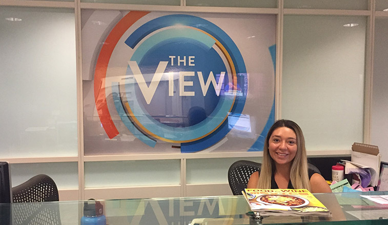 Student intern behind the reception desk at The View