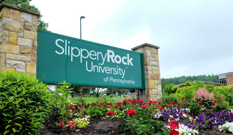 Campus sign and flowers