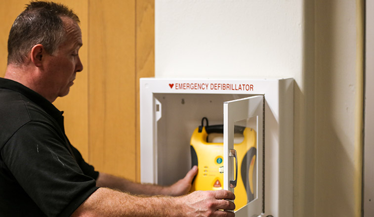 AED box being installed