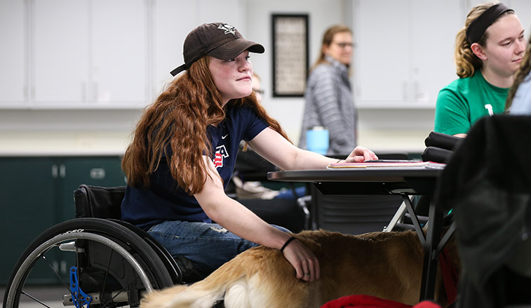 Female student with disabilities in a classroom