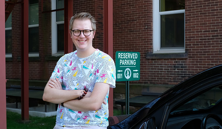 Student parking spot winner in the President's space