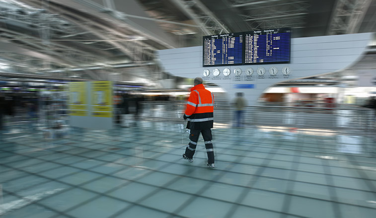 Police officer walking through the airport