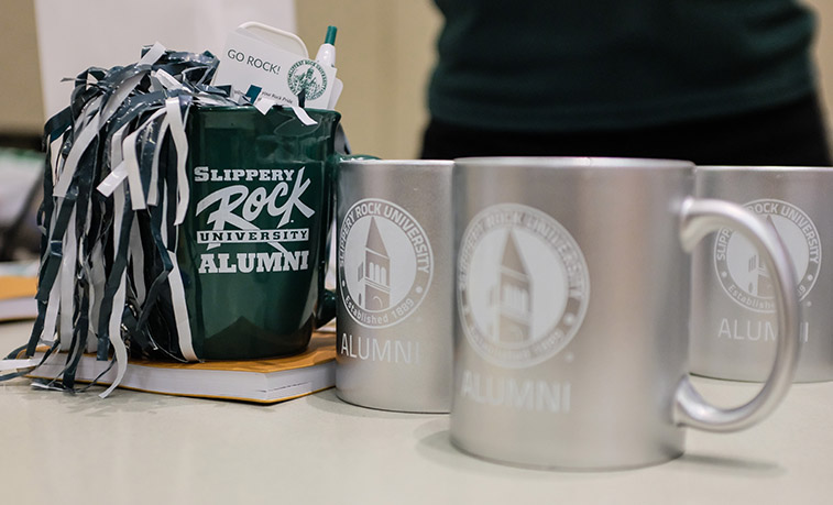 SRU Alumni mugs on display