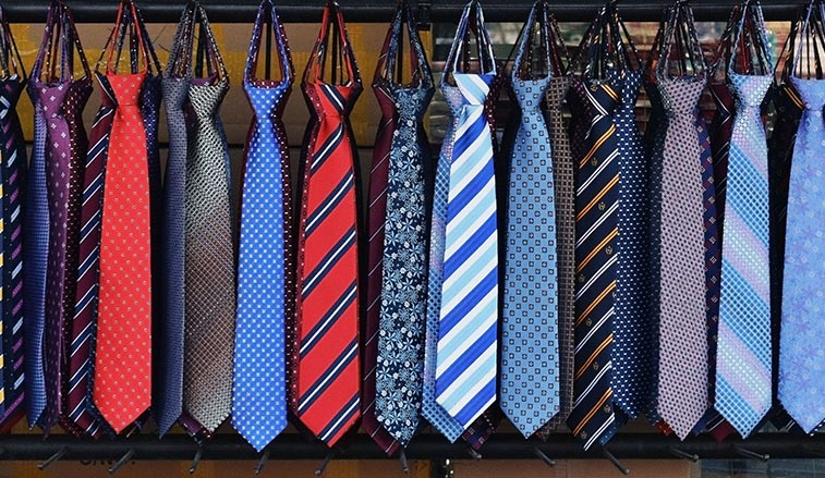 Neckties hanging on a rod