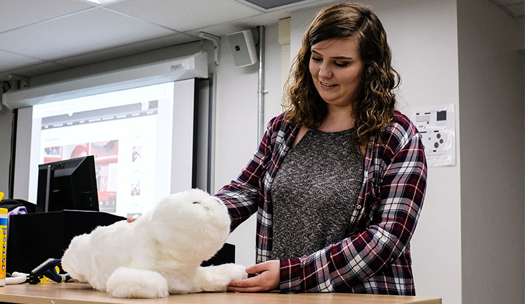 Female student working with the robotic seal