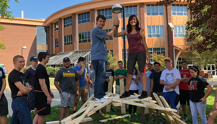 Students standing on top of their made Da Vinci bridge