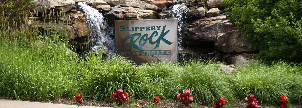 Slippery Rock University sign and fountain