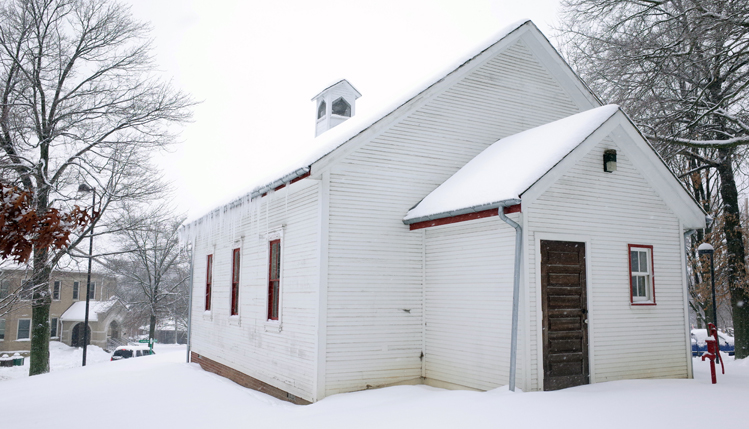 old school house in snow