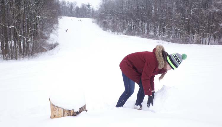 Woman Rolling snow