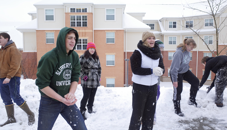 Students having fun in snow