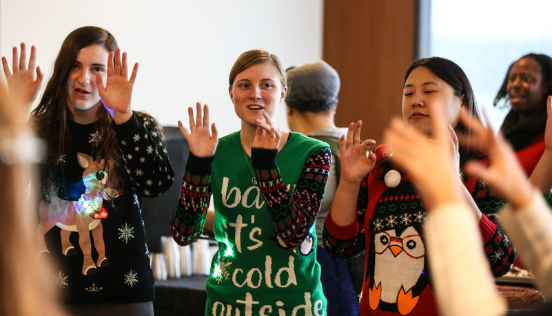 Stuednts performing a carol using sign language