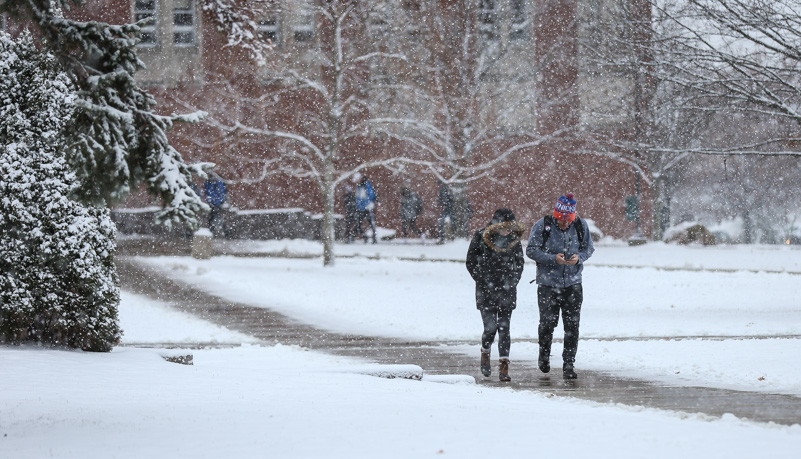 Students walking through the snow
