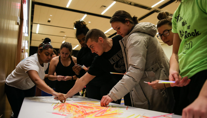 Students selecting glow sticks