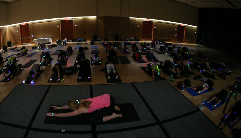 Students being led through yoga stretches