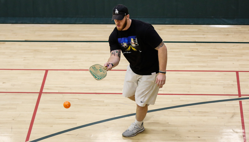 Man playing pickelball