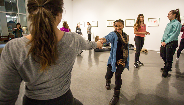 dance class rehearsing in art gallery