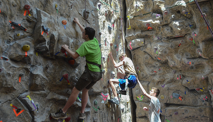 People climbing rock wall