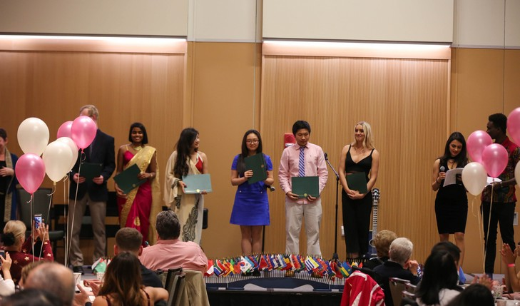 students presenting awards