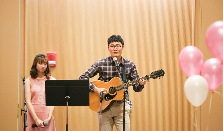 student playing guitar and singing