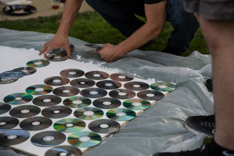 people making board with cd's