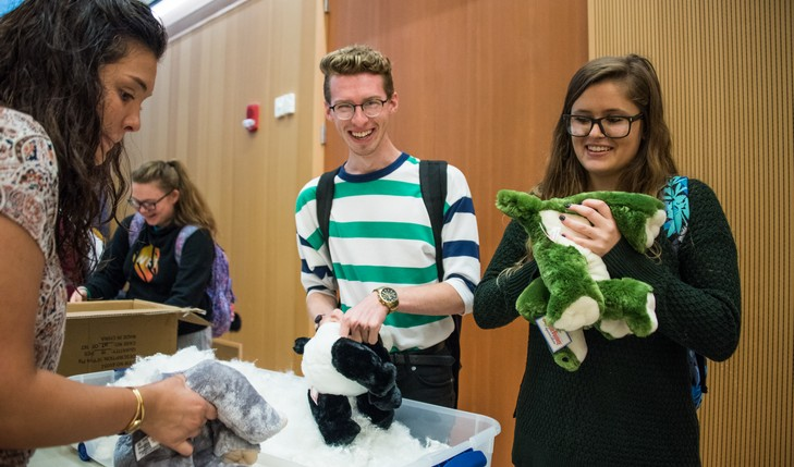 Students put stuffing in stuffed animal