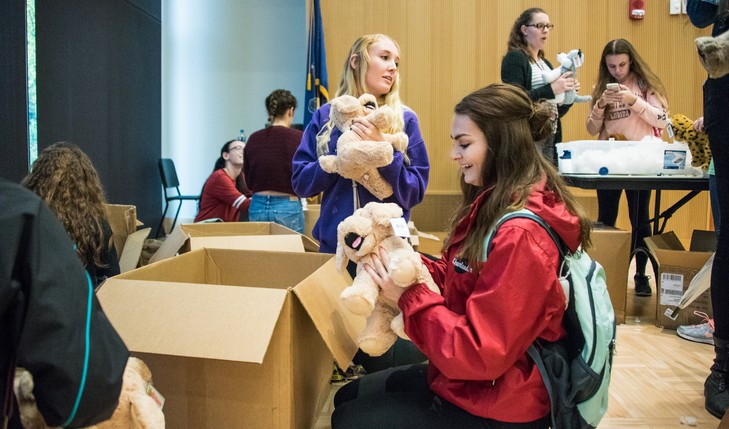 Students take stuffed animals out of boxes