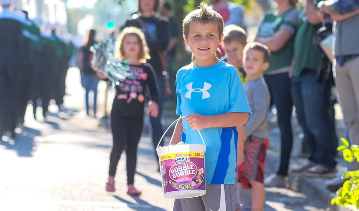 Child holds candy bucket
