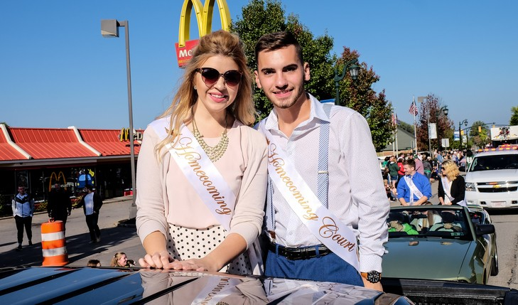 Homecoming court members ride in parade