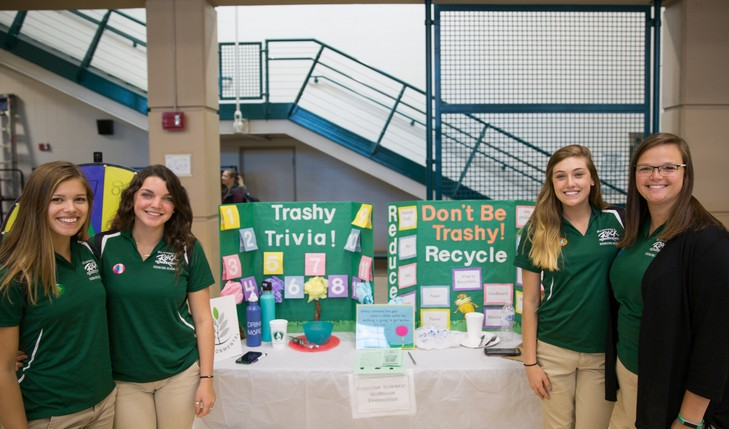 recycling booth with students