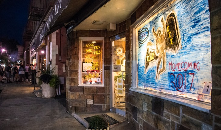 Art painted on windows of local business at night