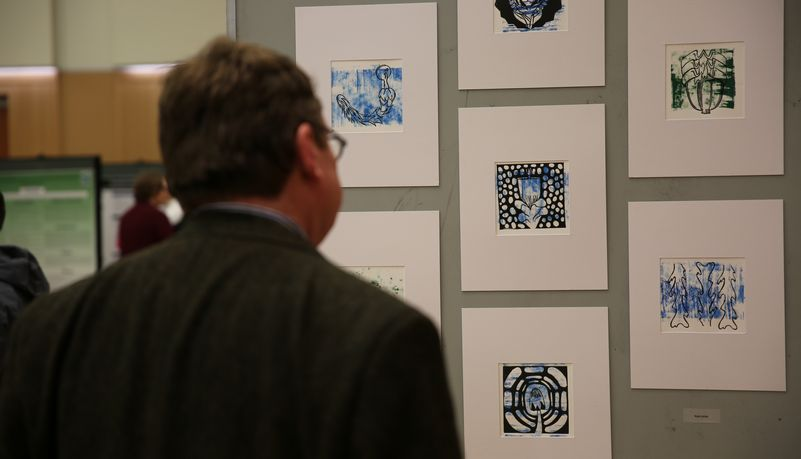 Man examining art exhibit