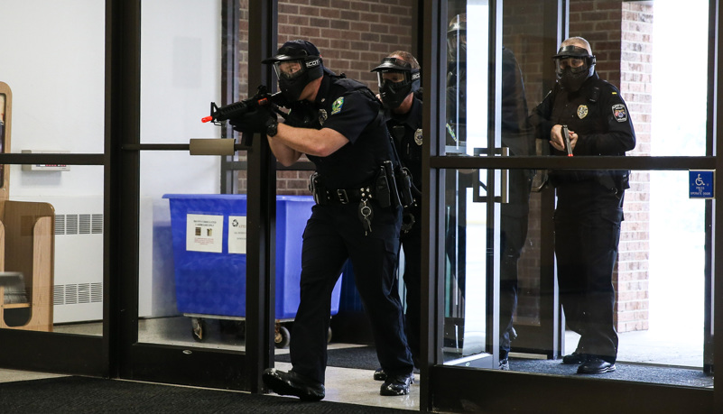 Police enter the building during the drill