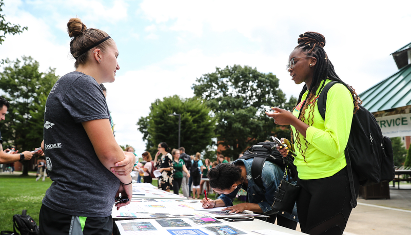 Student talking with a commuity organization member