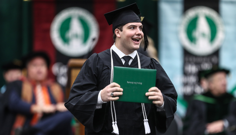 Graduate with his diploma